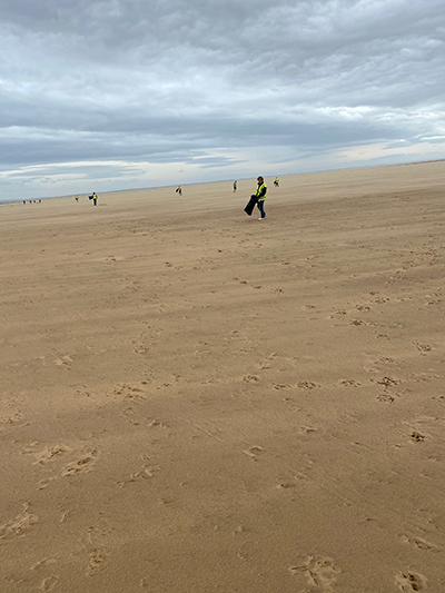 BiU litter picking team as far as the eye could see on St Annes beach